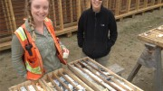 Barkerville Gold Mines senior geologists Maggie Layman (left) and Wanda Carter stand next to high-grade intercepts from the BC Vein at the Barkerville Mountain gold project in south-central British Columbia. Photo by Lesley Stokes.