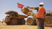 A worker directs traffic at Nordgold's Bissa gold mine in Guinea. Credit:  Nordgold