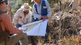 Geologists examine a map at Almaden Minerals' Ixtaca epithermal gold-silver deposit 95 km  north of Puebla City, Mexico. Credit: Almaden Minerals