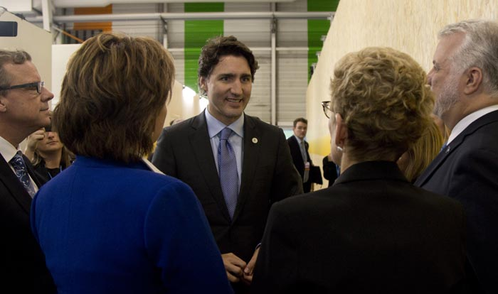 Canada's Prime Minister Justin Trudeau (centre) speaks with provincial premiers during the 2015 Paris Climate Conference. Credit: Province of British Columbia