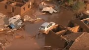 A screen shot of the wreckage caused by a large-scale tailing dam breach at the Samarco iron-ore joint venture in Brazil's Minas Gerais State. Source: YouTube