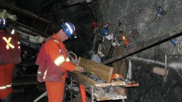 A geologist examines drill core in early 2015 on a drill platform 244 metres below the surface at Rubicon Minerals' Phoenix F2 gold deposit in northwestern Ontario. Credit: Rubicon Minerals