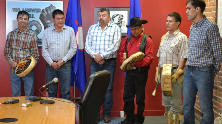 Tsilhqot'in Chiefs Drum after hearing Supreme Court Decision in June 2014, from left: Chief Francis Laceese (Tl'esqox); Chief Percy Guichon (Tsi Deldel); Tribal Chairman/Chief Joe Alphonse (Tl'etinqox); Vice-Chairman/Chief Roger William (Xeni Gwet'in); Chief Bernie Elkins (?Esdilagh); and Chief Russell Myers-Ross (Yunesit'in). Credit: Tsilhqot'in National Government