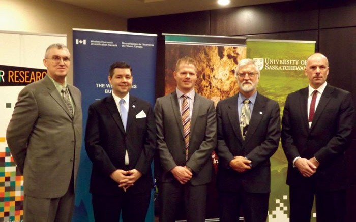 Following the research cluster announcement in Saskatoon, from left: Al Shpyth, IMII executive director; Jeremy Harrison, Saskatchewan's Minister Responsible for Innovation; Todd Steen, general manager of Agrium's Vanscoy potash mine; Jim Basinger, University of Saskatchewan associate VP of research; and David Malloy, University of Regina VP of research. Credit: IMII
