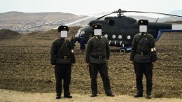 Soldiers guarding our Russian helicopter used to tour gold mines in North Korea in 1993. (Faces covered to hide their identities.) Photo by David Tyrwhitt