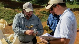Examining gold-silver samples at the Guapinol discovery on the Eastern Borosi property, from left: Greg Smith, Calibre Mining president and CEO; Robert Page, Iamgold director of exploration; and Marc Cianci, Calibre senior project geologist. Credit: Calibre Mining