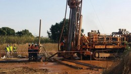 Workers with a reverse-circulation drill at Semafo's Natougou gold project, 320 km east of Ouagadougou, Burkina Faso.  Credit: Semafo