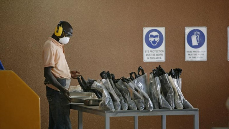 A worker bags samples at Orezone Gold's Bombore project in Burkina Faso. Credit: Orezone Gold