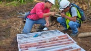 Workers study drill core at RTG Mining's Mabilo copper-gold-magnetite project in southeastern Luzon in the Philippines. Credit: RTG Mining