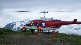Unloading a helicopter at on Johnny Flats at SnipGold's Iskut project in the Golden Triangle of northwestern British Columbia. Credit: SnipGold