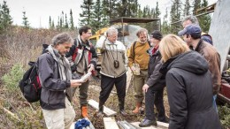 Sirios Resources president and CEO Dominique Doucet (far left) examines a core sample during a site visit to the Cheechoo gold project, 320 km north of Matagami, Quebec, in 2014. Credit: Sirios Resources.