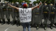 "AFP photo of protester in Caracas, Venezuela, with sign reading ""There is no food."" Credit: AFP/file."