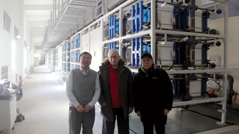 The project team in front of the 8 MW hour vanadium flow battery at the Zhangbei renewable energy project in February, 180 km north of Beijing, from left: chief technical officer Huang Mianyan, project coordinator Lee Barker and commercial manager Charles Ge. Credit: Sparton Resources.