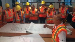 Integra Gold's senior vice-president of exploration Hervé Thiboutot (front) explains the geology of the Triangle and No. 4 Plug gold deposits to analysts and investors during a site visit in July. Photo by Lesley Stokes.