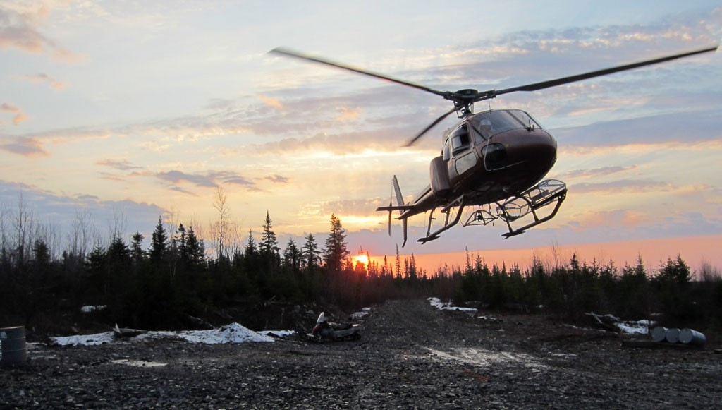 A helicopter near Balmoral Resources' Bug Lake and Martiniere West gold deposits, part of the larger Detour Trend project in central Quebec. Credit: Balmoral Mining.
