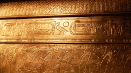 Golden ancient Egyptian hieroglyphs.