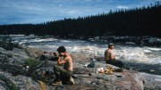 Angus Wilbur (left) and Vernon Smith have lunch near Iroquois chute on the Nottaway River in the Evans Lake area of northwestern Quebec in the summer of 1959. Photo by Harold Linder.