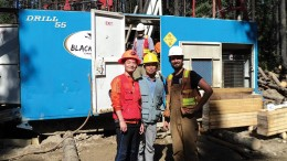 At a drill site on Serengeti Resources' Kwanika copper-gold property, 250 km east of Smithers, B.C,. from left: Posco Daewoo's Ji Su Go and Kyu-Youl Sung, and geologist Cole Godfrey. Credit: Serengeti Resources.