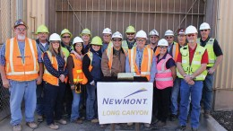 Members of Newmont Mining's Long Canyon team pose with one of the first gold bars produced at the mine in Elko County, Nevada. Credit: Newmont Mining.