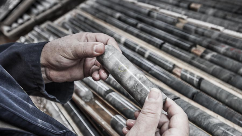 An employee examines drill core at Richmont Mines' Island gold mine. Credit: Richmont Mines.