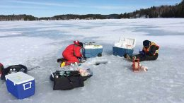 At a nickel-copper mine in northern Ontario, personnel in Lesley Warren's group collect winter samples for geochemical and microbiological analyses from a tailings pond. Credit: Lassonde Mining Institute.