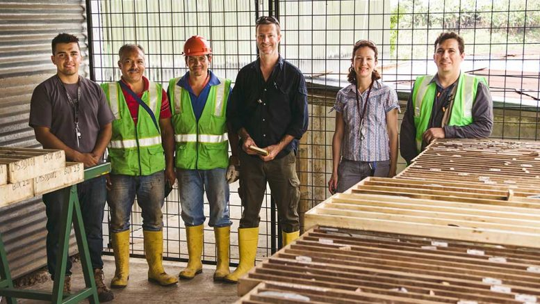 Toachi Mining exploration manager Phil Fox (fourth from left) with associates in a core facility in the village of Palo Quemado, Ecuador. Credit: Toachi Mining.