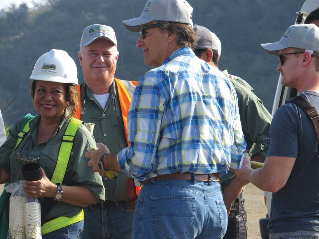 Orla Mining's social and environmental director Hilda Candanedo (far left) and investor Pierre Lassonde (back to camera) chatting at the Cerro Quema project. Credit: Orla Mining.