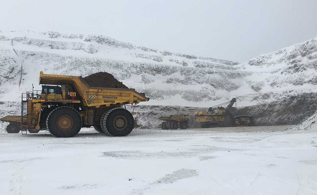 Haul trucks with a shovel in the background at Iron Ore Co. of Canada's Wabush 3 iron ore mine in Labrador. Credit: Rio Tinto.