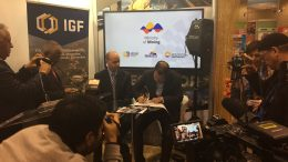 Ecuador's mines minister Javier Cordova signs agreement to join IGF, as IGF director Greg Radford looks on. The signing took place on March 7 at the PDAC convention. Photo by Salma Tarikh