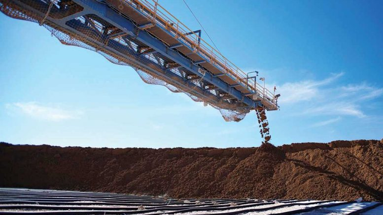 Material leaves a conveyor at BHP Billiton's Escondida copper mine in Chile. Credit: BHP Billiton.