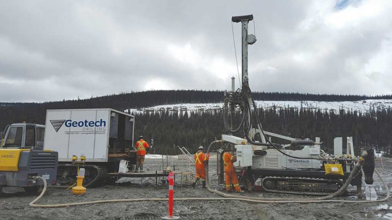 Workers and a drill rig at Barkerville Gold Mines' Cow Mountain project, part of its Cariboo gold property in south-central British Columbia. Credit: Barkerville Gold Mines.