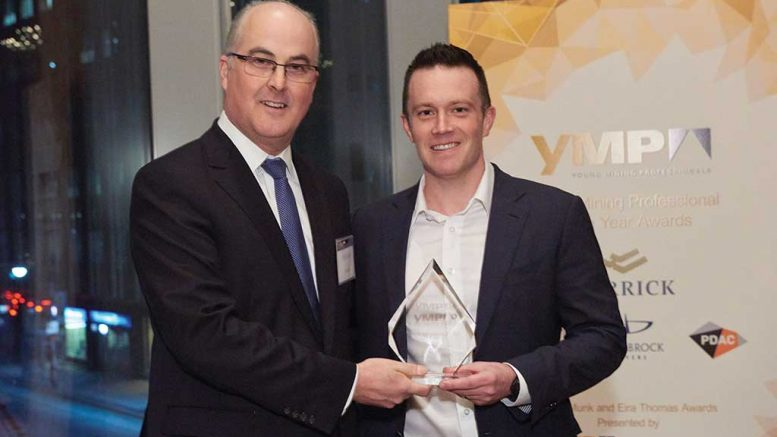 Peter Sinclair (left), chief sustainability officer at Barrick Gold, presents Nolan Watson, president and CEO of Sandstorm Gold, with the Young Mining Professionals' Peter Munk Award for 2016.  Credit: YMP.