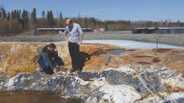 Probe Metals' vice-president of corporate development Patrick Langlois (left) and chief operating officer Yves Dessureault examine outcrop at the Val-d'Or East gold property in Quebec. Credit: Probe Metals.