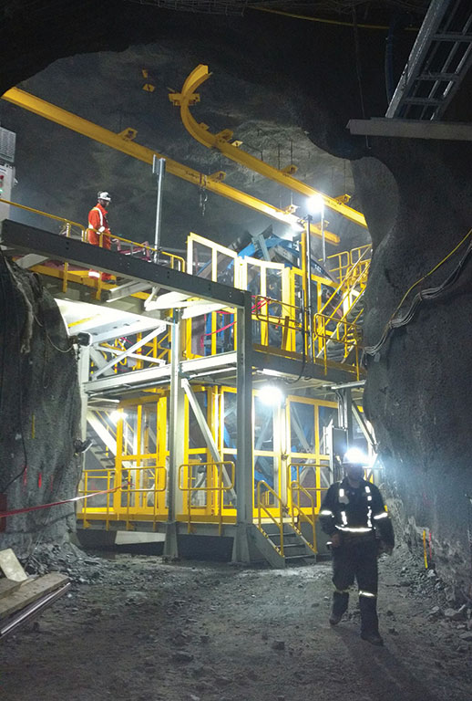 Workers at a section of the Rail-Veyor system at Agnico Eagle Mines' Goldex underground gold mine near Val-d'Or, Quebec. Photo by Jon Cumming.