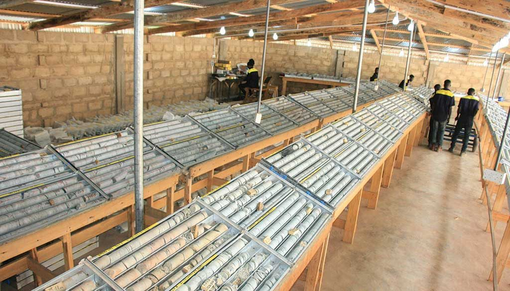 Workers in the core shack at the Namdini gold project. Credit: Cardinal Resources.