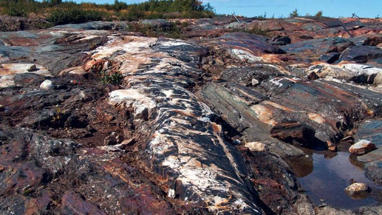"""An outcrop with visible veining and """"piano key"""" breccia at the proposed pit location Eastmain Resources' Eau Claire gold project in Quebec's James Bay region. Credit: Eastmain Resources."""