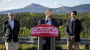 Yukon Premier Sandy Silver at the podium in Whitehorse, Yukon, on Sept. 2 to announce the $360-million Yukon Resource Gateway Project to improve roads in the Yukon, with Prime Minister Justin Trudeau (right) and Yukon Member of Parliament Larry Bagnell. Credit: CP.