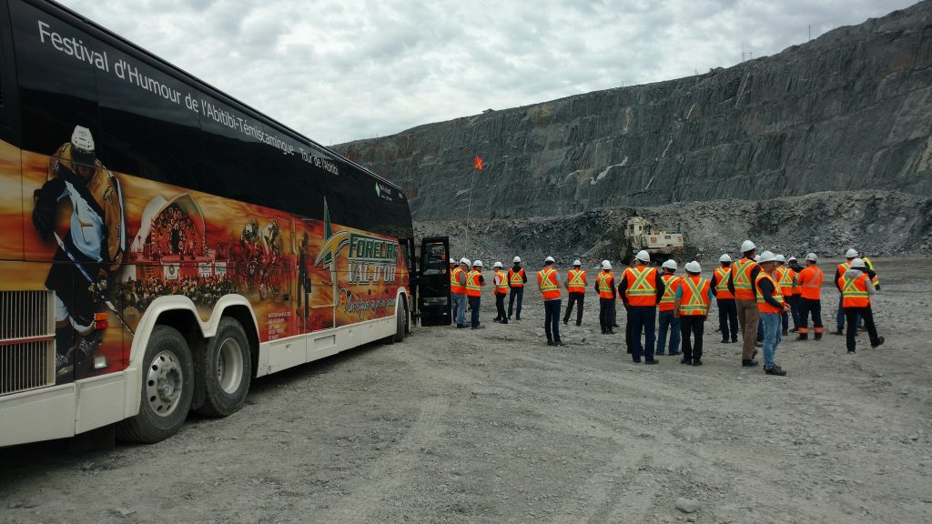 Visitors on the pit floor at Agnico Eagle Mines and Yamana Gold's Canadian Malartic gold mine in Malartic, Quebec. Photo by John Cumming.