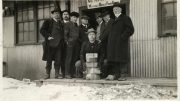J.P. Bickell holding five gold bars while the McIntyre mine's directors look on. Credit: MacLachlan Family Collection.