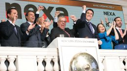 Nexa Resources CEO Tito Martins (centre) and colleagues open the New York Stock Exchange to mark the firm's arrival in North American markets. Credit: Nexa Resources.