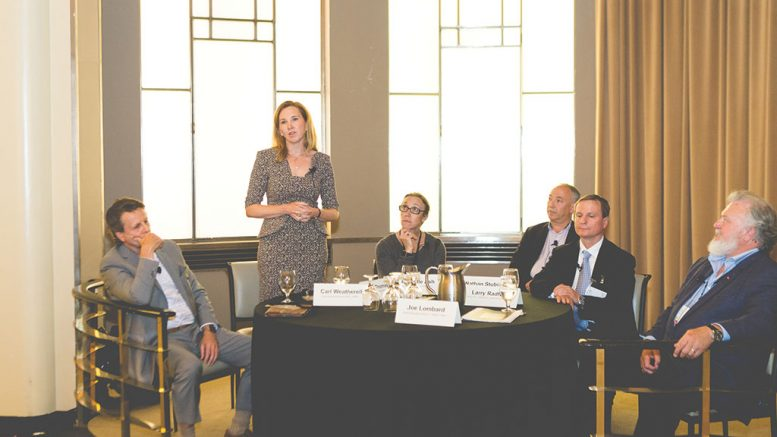Eira Thomas, director of Lucara Diamond, stands to address delegates during a roundtable at the Progressive Mine Forum organized by The Northern Miner in October. Photo by George Matthew Photography.