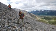 Fireweed Zinc CEO Brandon Macdonald (background) and consulting geologist Scott Dorion from SGDS Hive on a talus slope at the Macmillan Pass zinc-lead-silver property in southeastern Yukon. Photo by Robert Cameron.