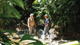 Jean-Paul Pallier (left), Aurania Resources' vice-president of exploration, and Richard Spencer, president, discussing stream sediment sampling techniques at the Lost Cities-Cutucu gold project in Ecuador. Credit: Aurania Resources.