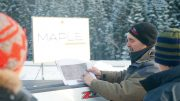 Fred Speidel,Maple Gold Mines' vice-president of exploration, holds a map at the Douay gold project in Quebec's Abitibi greenstone belt. Credit: Maple Gold Mines.