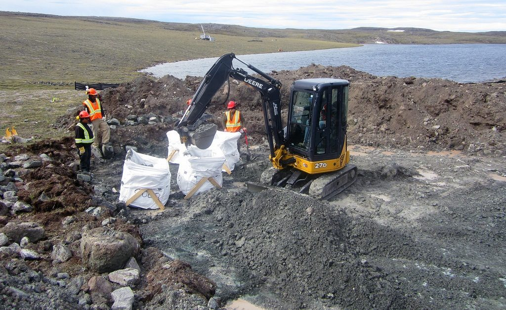 Taking a 200-tonne sample in July 2017 at Q1-4 while drilling continues in the background. Credit: North Arrow Minerals Inc.