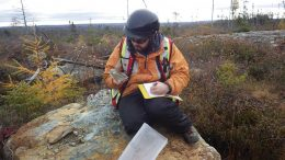 Altius Minerals geologist Nick Barnable takes field notes in Newfoundland. Credit: Altius Minerals.