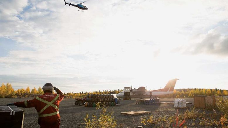 A helicopter above the airstrip at Nighthawk Gold's Indin Lake gold project in the Northwest Territories. Credit: Nighthawk Gold.