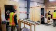 First Mining Staff cut core at Goldlund's facility near Dryden, Ontario. Credit: First Mining.