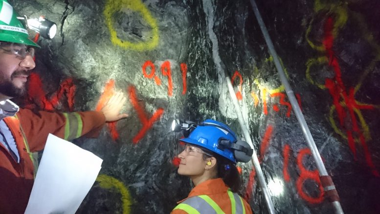 Alamos Staff indicate points of interest on a the face of a tunnel more than 800 metres underground at the Island Gold mine. Photo by Richard Quarisa.