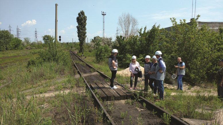 Examining rail infrastructure built alongside Black Iron's Shymanivske iron ore deposit near Kryvyi Rih, Ukraine. Photo by John Cumming.